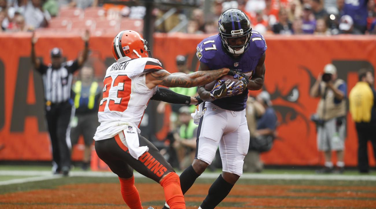 FILE - In this Sept. 18, 2016, file photo, Baltimore Ravens wide receiver Mike Wallace (17) catches a touchdown agains Cleveland Browns cornerback Joe Haden (23) in the first half of an NFL football game,  in Cleveland. The Ravens have scored three touchd