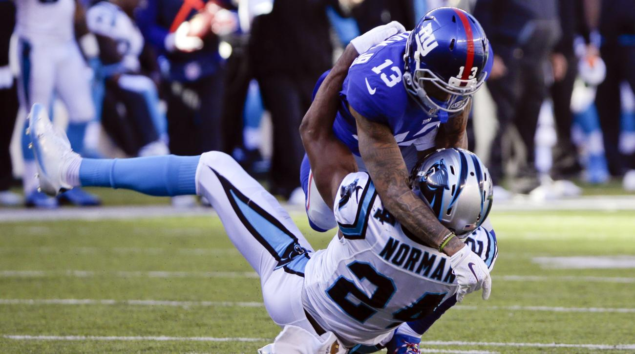 FILE - In this Dec. 20, 2015, file photo, New York Giants wide receiver Odell Beckham (13) and Carolina Panthers' Josh Norman (24) grapple during the first half of an NFL football game in East Rutherford, N.J. Whether the receiver and Norman, now a Redski