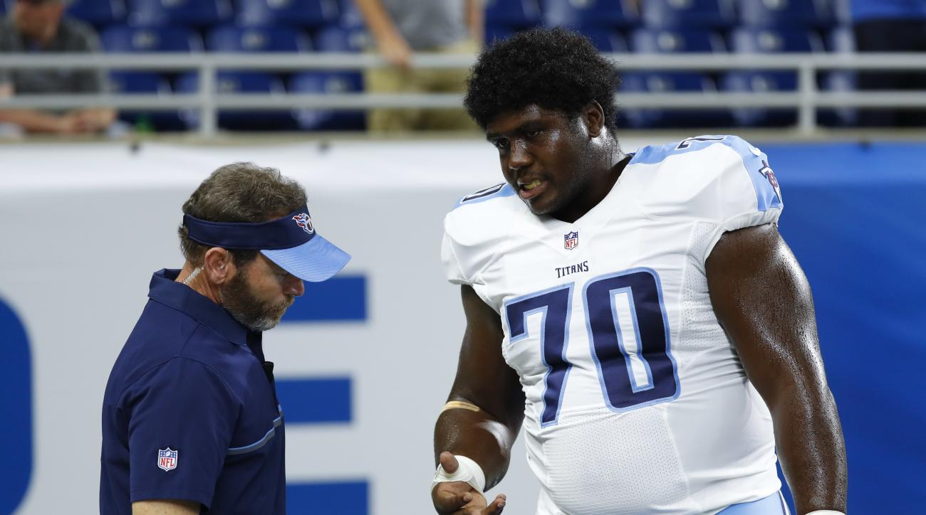 FILE - In this Sunday, Sept. 18, 2016, file photo, Tennessee Titans guard Chance Warmack (70) has his hand checked by a trainer before an NFL football game against the Detroit Lions in Detroit. Warmack will have surgery to repair a torn tendon in a finger