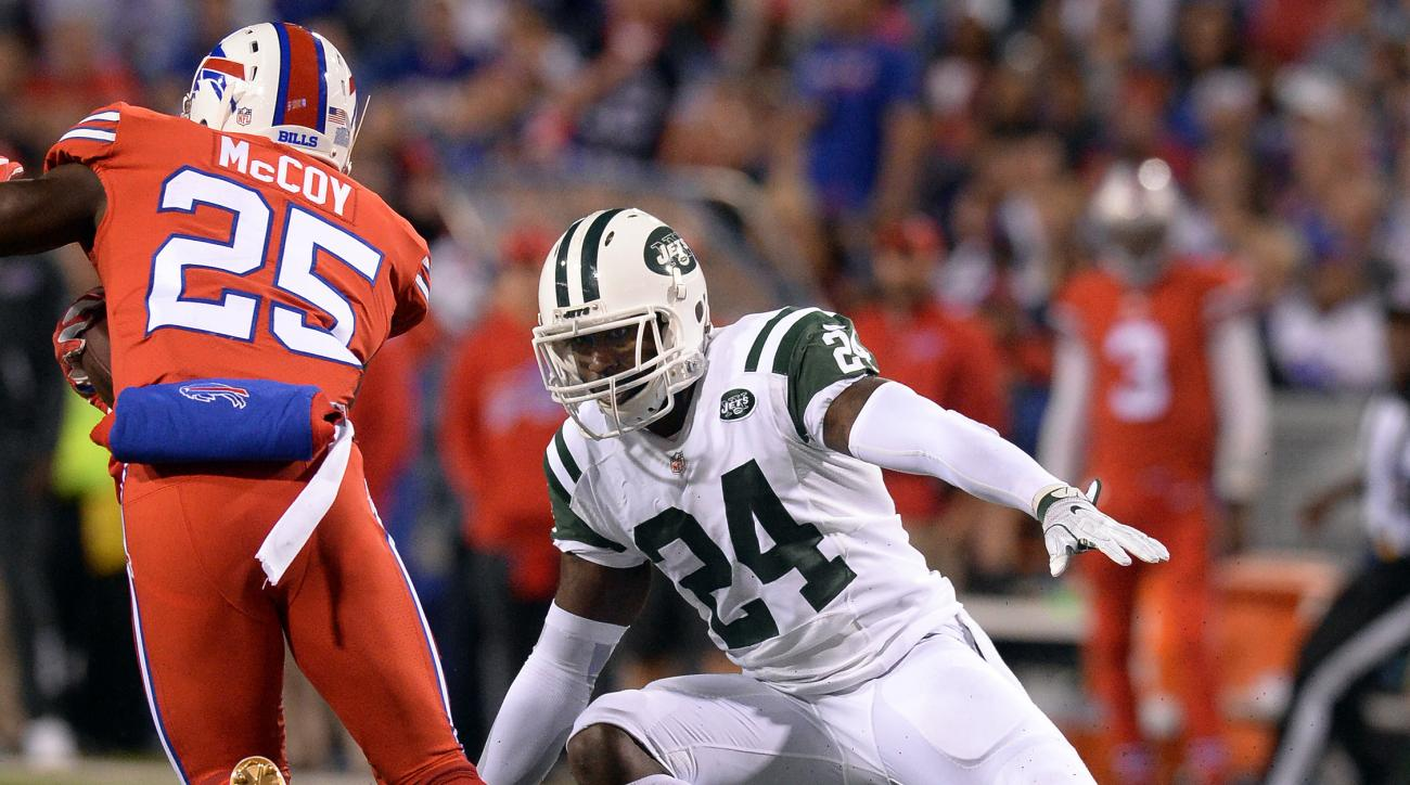 In this Thursday, Sept. 15, 2016, photo, New York Jets cornerback Darrelle Revis (24) prepares to tackle Buffalo Bills running back LeSean McCoy (25) during the first half of an NFL football game in Orchard Park, N.Y. Revis says a report that he came to t
