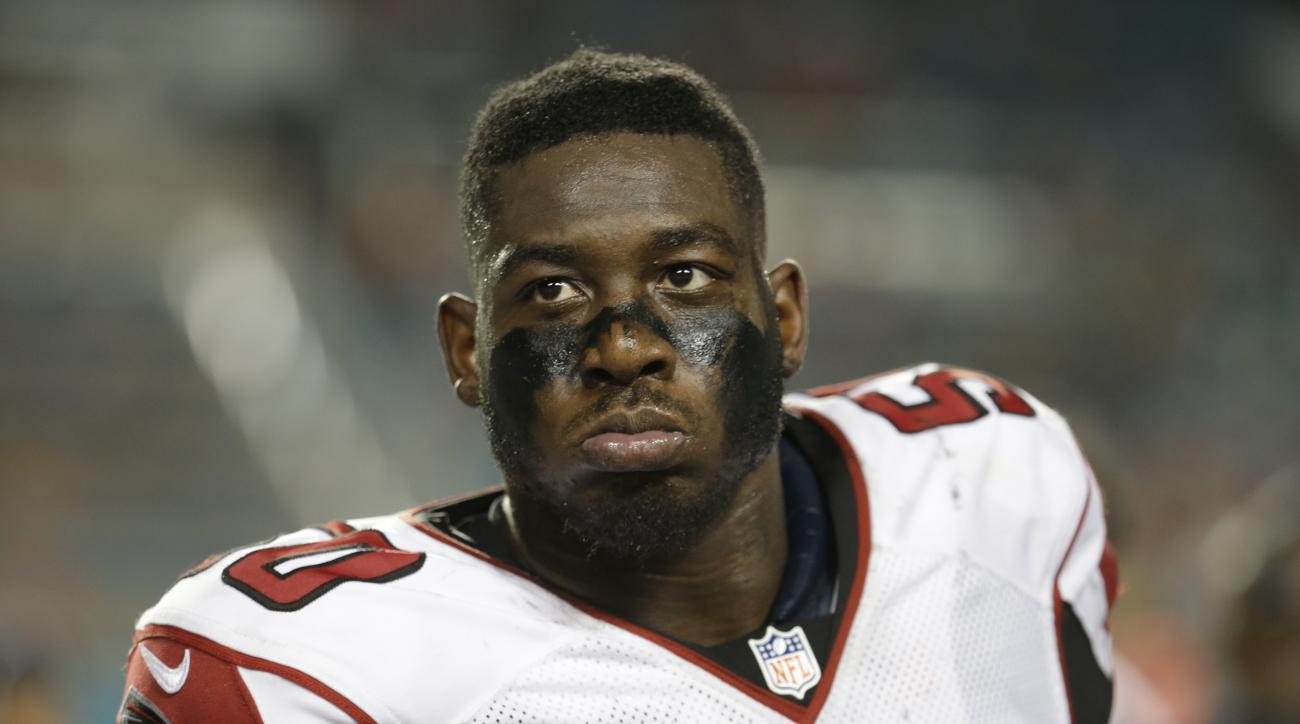 FILE - In this Aug. 29, 2015, file photo, Atlanta Falcons linebacker O'Brien Schofield (50) watches from the sidelines during the first half of an NFL preseason football game against the Miami Dolphins in Miami Gardens, Fla. Schofield, who started 10 game