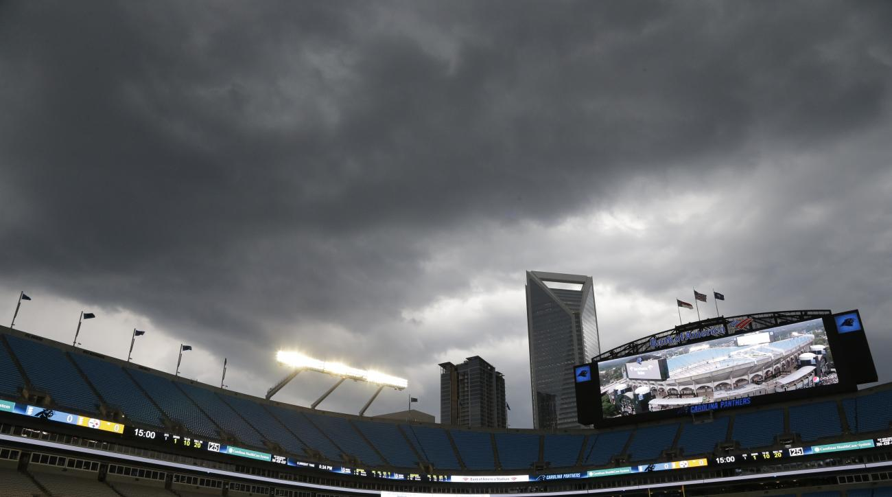 Storm clouds roll over Bank of America Stadium before a preseason NFL football game between the Carolina Panthers and the Pittsburgh Steelers in Charlotte, N.C., Thursday, Sept. 1, 2016. (AP Photo/Bob Leverone)