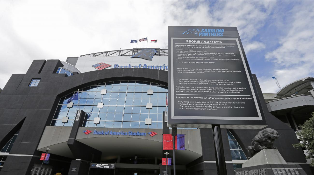 A security sign is displayed in front an entrance to Bank of America Stadium after a second night of violence following Tuesday's fatal police shooting of Keith Lamont Scott in Charlotte, N.C. Thursday, Sept. 22, 2016. With Charlotte being in a state of e