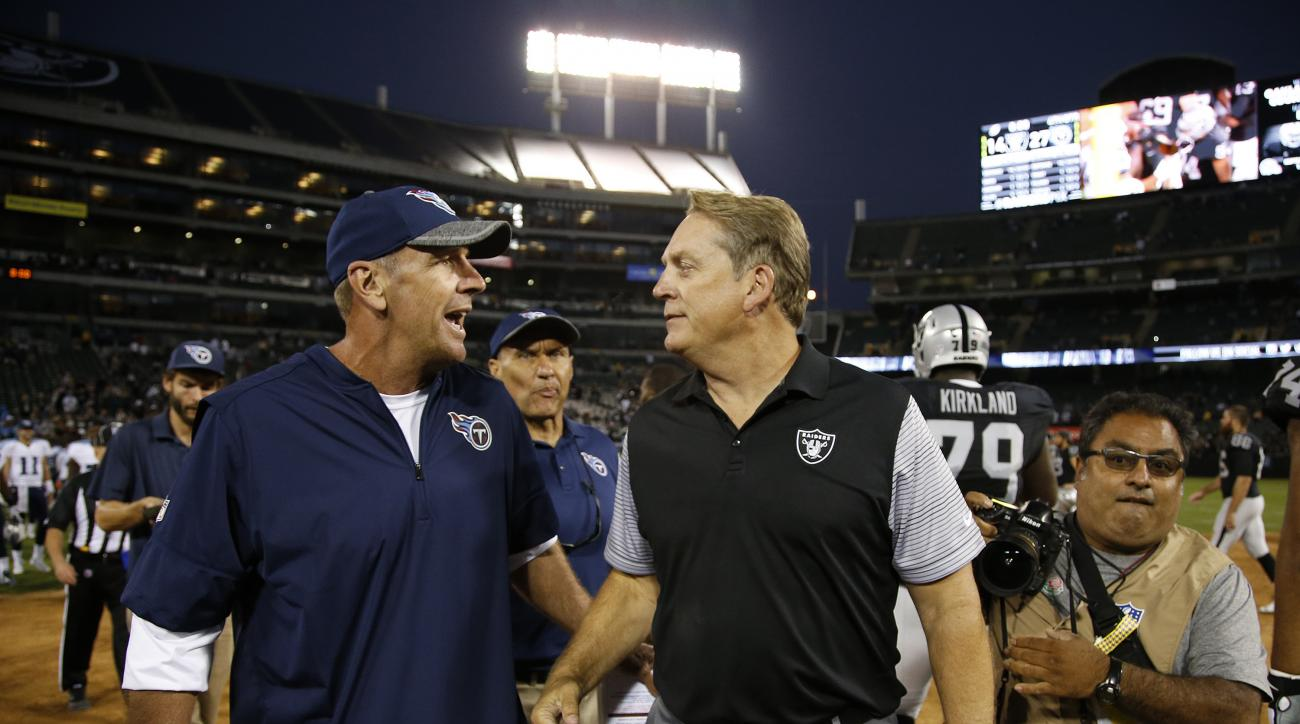 FILE - In this Aug. 27, 2016, file photo, Tennessee Titans head coach Mike Mularkey, left, and Oakland Raiders head coach Jack Del Rio, right, greet each other after an NFL preseason football game in Oakland, Calif. These teams know each other very well.