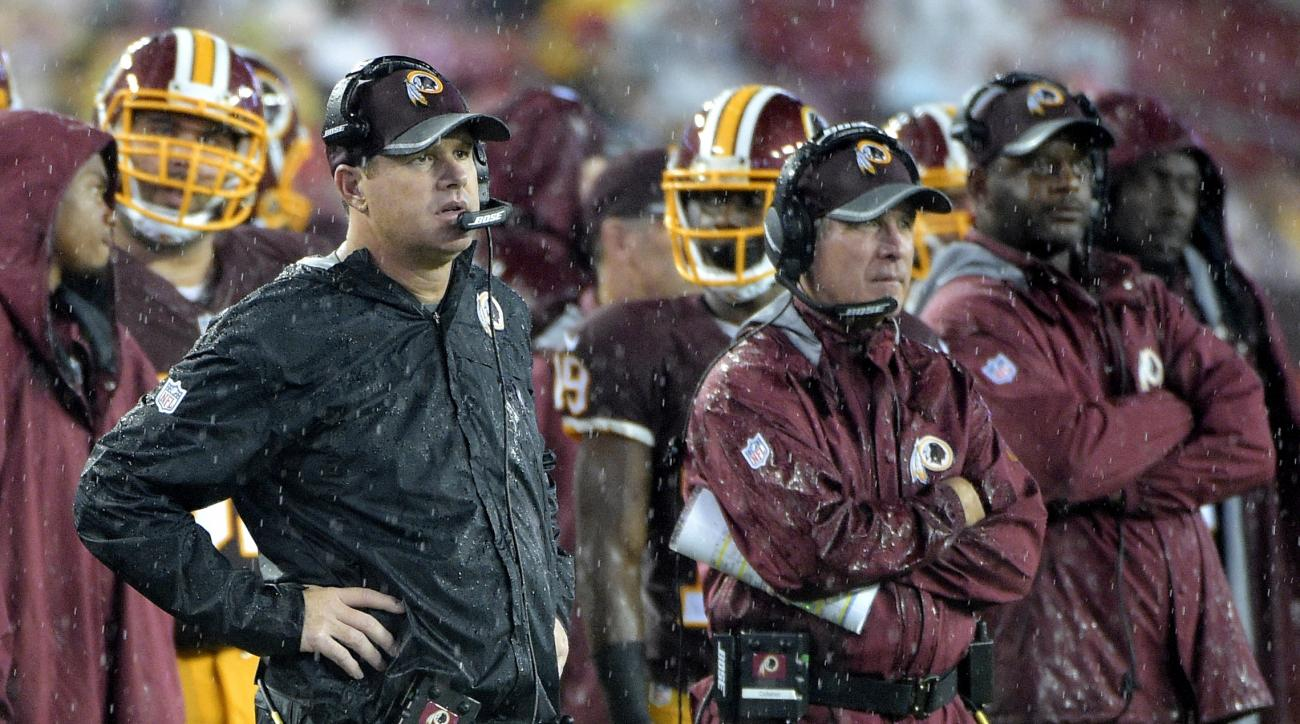 FILE - In this Aug. 31, 2016, file photo, Washington Redskins head coach Jay Gruden watches from the sideline during the first half of an NFL preseason football game against the Tampa Bay Buccaneers in Tampa, Fla. While the New York Giants are off to thei