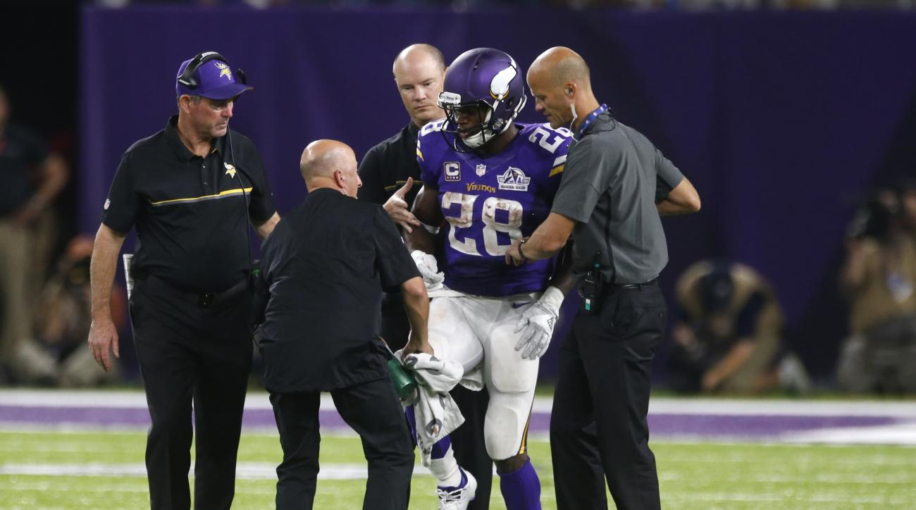 FILE - In this Sunday, Sept. 18, 2016, file photo, Minnesota Vikings running back Adrian Peterson (28) is helped off the field after getting injured during the second half of an NFL football game against the Green Bay Packers in Minneapolis. The Vikings a