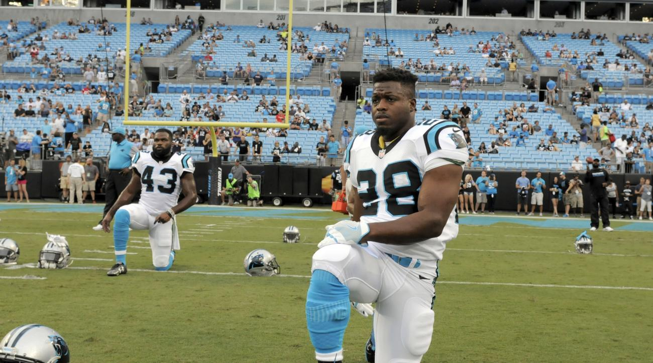 FILE - In this Aug. 26, 2016, file photo, Carolina Panthers' Jonathan Stewart (28) warms up before an NFL preseason football game against the New England Patriots in Charlotte, N.C. The Vikings and Panthers will be counting on their backup running backs w