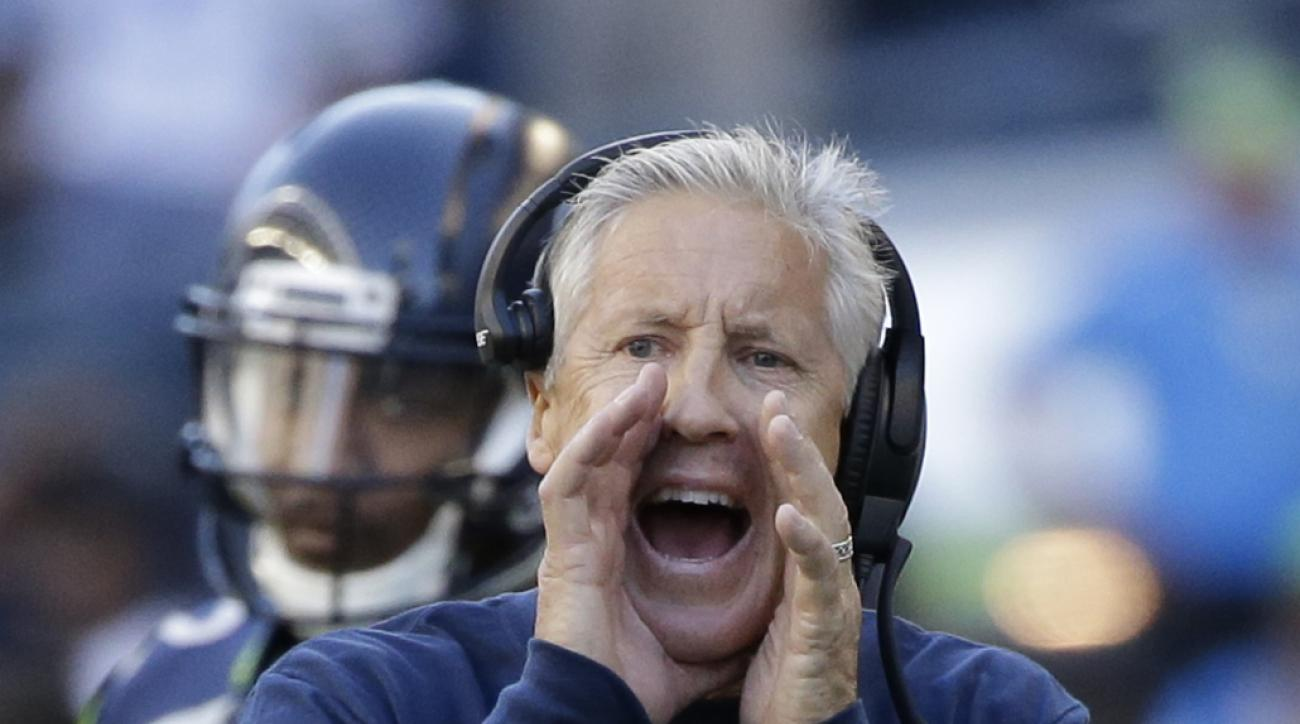 File- This Sept. 11, 2016, file photo shows Seattle Seahawks head coach Pete Carroll yelling to his team against the Miami Dolphins in the second half of an NFL football game in Seattle. Chip Kelly and Carroll overlapped for only one season as college coa