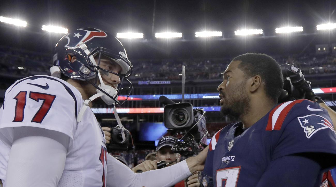 Houston Texans quarterback Brock Osweiler, left, and New England Patriots quarterback Jacoby Brissett speak at midfield after an NFL football game Thursday, Sept. 22, 2016, in Foxborough, Mass. The Patriots won 27-0. (AP Photo/Charles Krupa)
