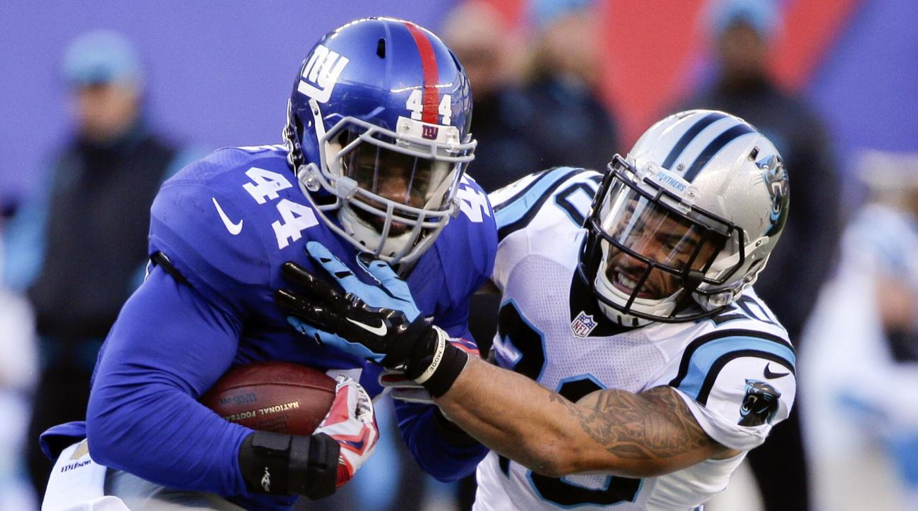 FILE- In this Dec. 20, 2015, file photo, Carolina Panthers' Kurt Coleman (20) tackles New York Giants' Andre Williams (44) during the first half of an NFL football game Sunday, Dec. 20, 2015, in East Rutherford, N.J. Coleman was cut by Vikings coach Mike