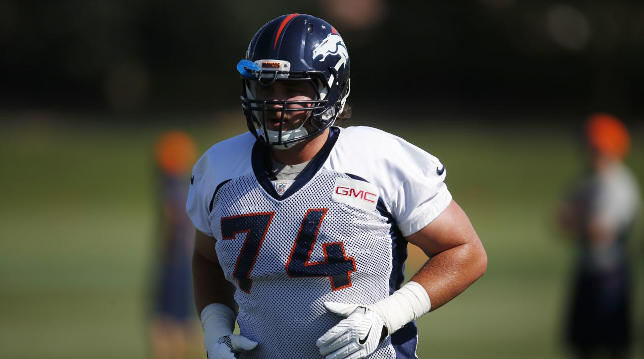 FILE - In this July 28, 2016, file photo, Denver Broncos offensive tackle Ty Sambrailo (74) takes part in drills during NFL football training camp in Englewood, Colo. Sambrailo, who's been out a year, could make his return to the Denver Broncos' lineup Su