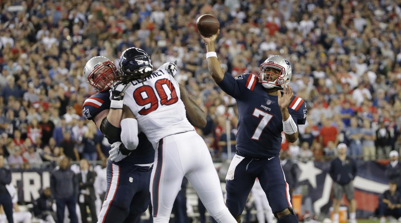 In this Thursday, Sept. 22, 2016 photo, New England Patriots quarterback Jacoby Brissett (7) passes over Houston Texans defensive end Jadeveon Clowney (90) during the second half of an NFL football game Thursday, Sept. 22, 2016, in Foxborough, Mass. The p