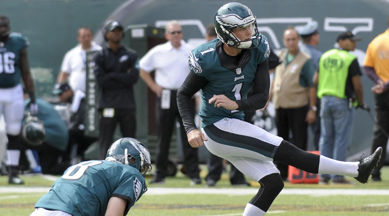 FILE - In this Sept. 27, 2015 file photo, Philadelphia Eagles kicker Cody Parkey (1) kicks a field goal with punter Donnie Jones (8) holding during the first quarter of an NFL football game against the New York Jets in East Rutherford, N.J. The Cleveland