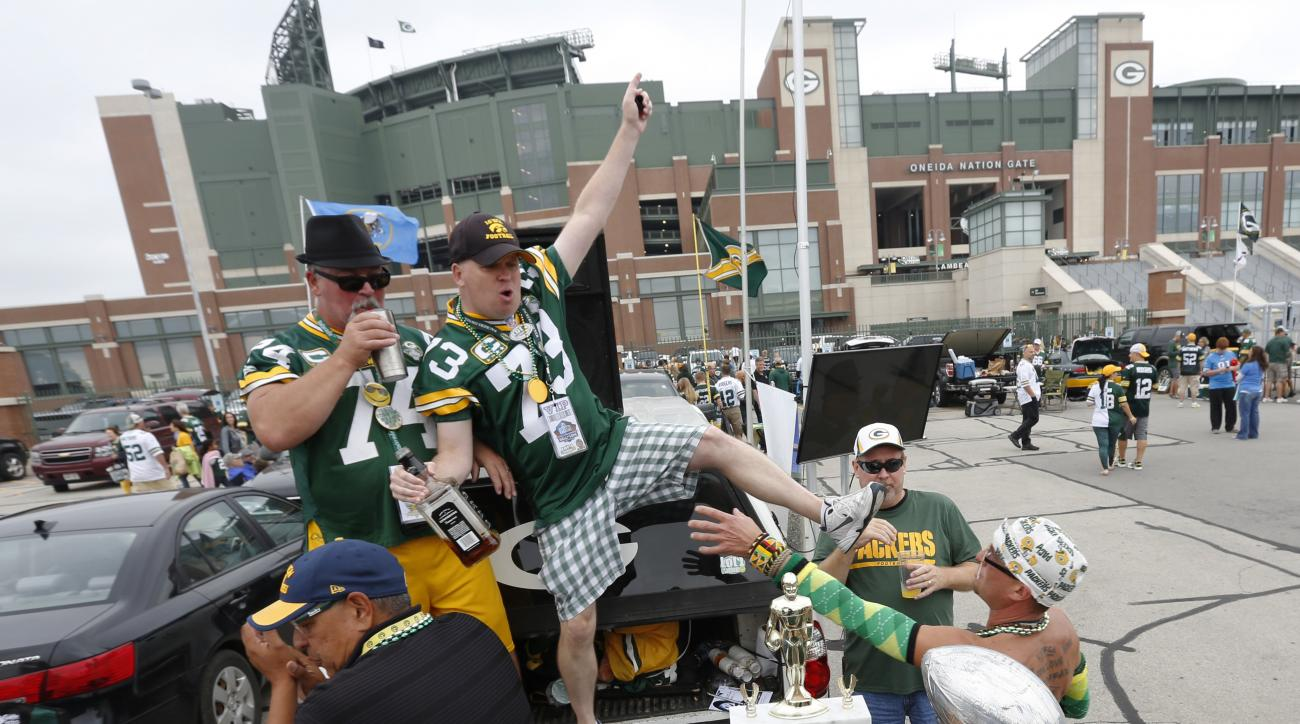 Fans tailgate outside Lambeau Field before an NFL football game between the Green Bay Packers and the Detroit Lions Sunday, Sept. 25, 2016, in Green Bay, Wis. (AP Photo/Mike Roemer)