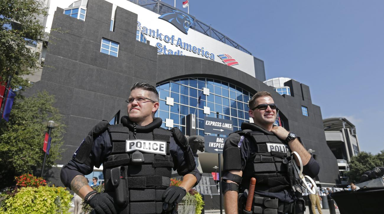 Charlotte-Mecklenburg Police officers stand guard outside Bank of America Stadium before an NFL football game between the Carolina Panthers and the Minnesota Vikings in Charlotte, N.C., Sunday, Sept. 25, 2016. Increased security is in place for the game a