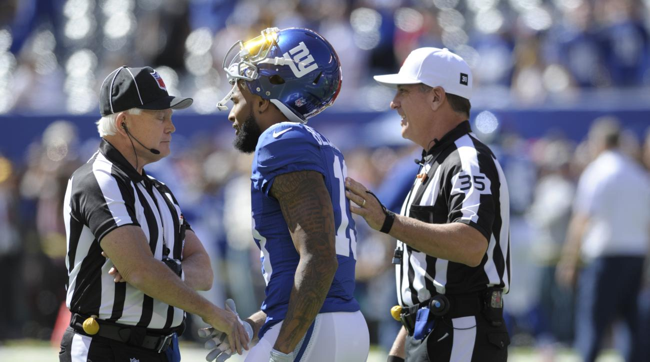 New York Giants wide receiver Odell Beckham (13) talks to officials before an NFL football game against the Washington Redskins Sunday, Sept. 25, 2016, in East Rutherford, N.J. (AP Photo/Bill Kostroun)