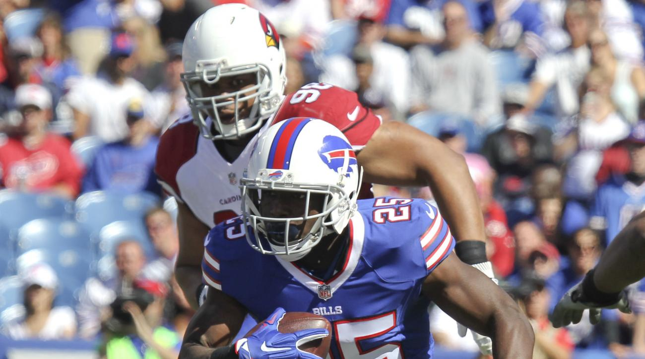 Buffalo Bills running back LeSean McCoy (25) runs away from Arizona Cardinals nose tackle Josh Mauro (97) and defensive tackle Corey Peters (98) during the first half of an NFL football game on Sunday, Sept. 25, 2016, in Orchard Park, N.Y. (AP Photo/Jeffr