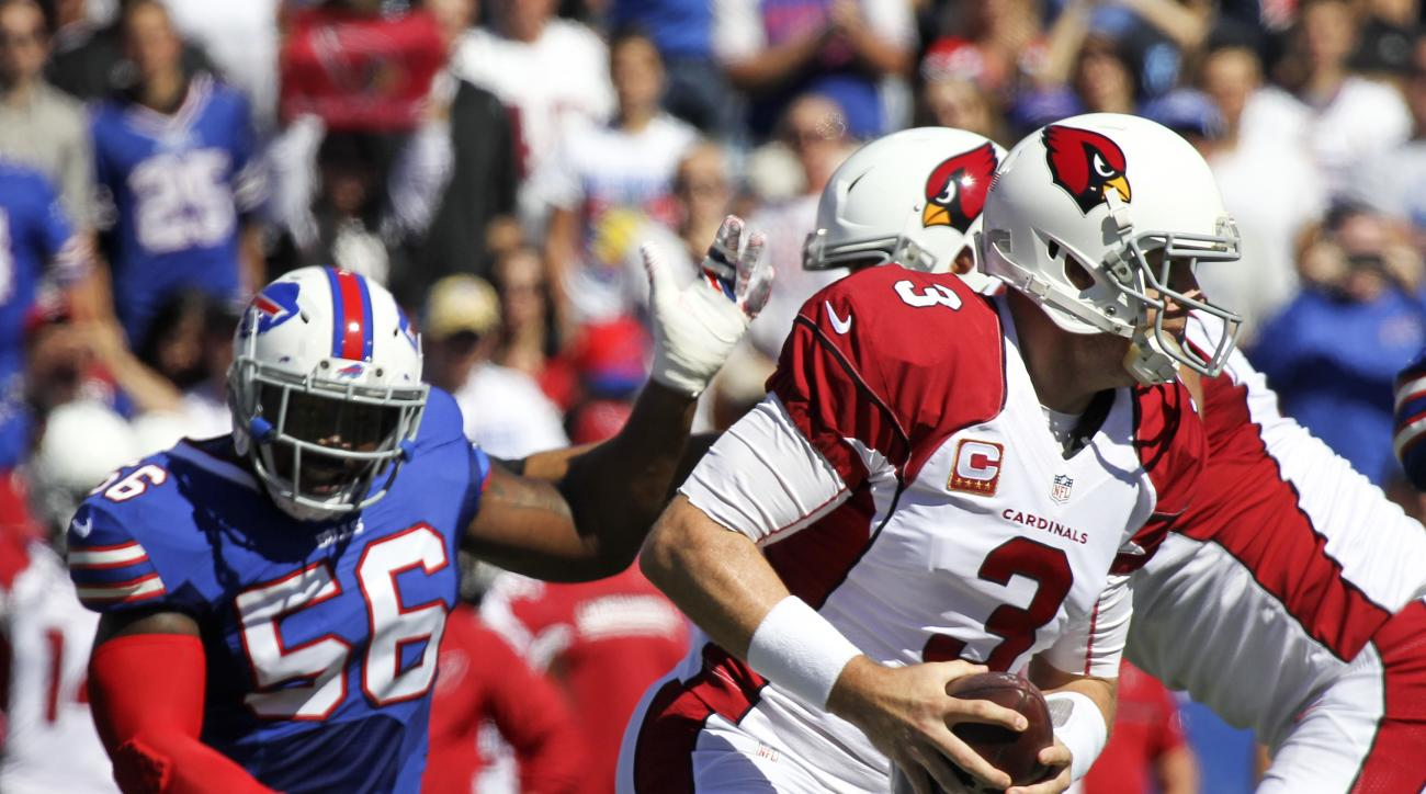 Arizona Cardinals quarterback Carson Palmer (3) is pressured by Buffalo Bills linebacker Lerentee McCray (56) during the first half of an NFL football game on Sunday, Sept. 25, 2016, in Orchard Park, N.Y. (AP Photo/Jeffrey T. Barnes)