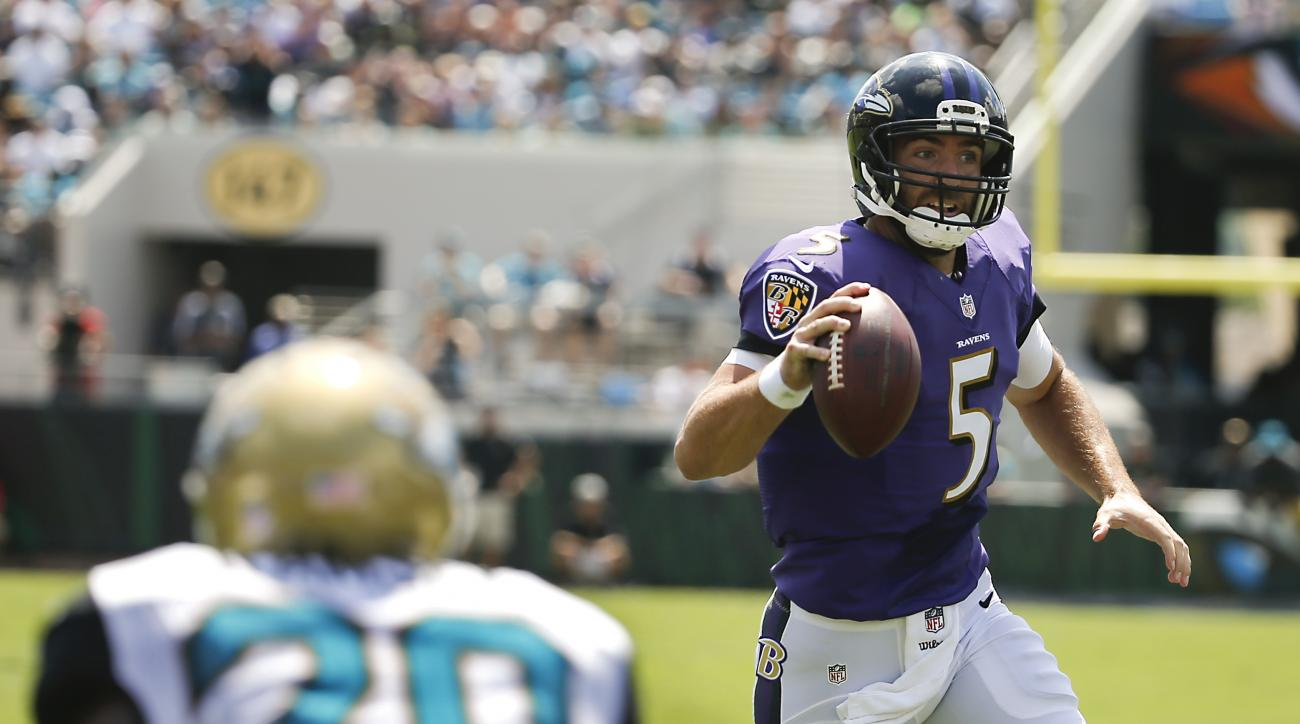 Baltimore Ravens quarterback Joe Flacco (5) rushes past Jacksonville Jaguars cornerback Jalen Ramsey (20) for a 7-yard touchdown run during the first half of an NFL football game in Jacksonville, Fla., Sunday, Sept. 25, 2016. (AP Photo/Stephen B. Morton)