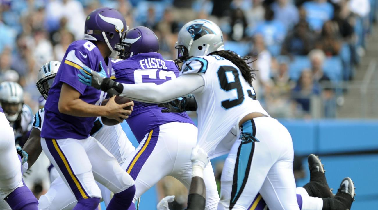 Minnesota Vikings' Sam Bradford (8) is sacked by Carolina Panthers' Lavar Edwards (93) in the first half of an NFL football game in Charlotte, N.C., Sunday, Sept. 25, 2016. (AP Photo/Mike McCarn)