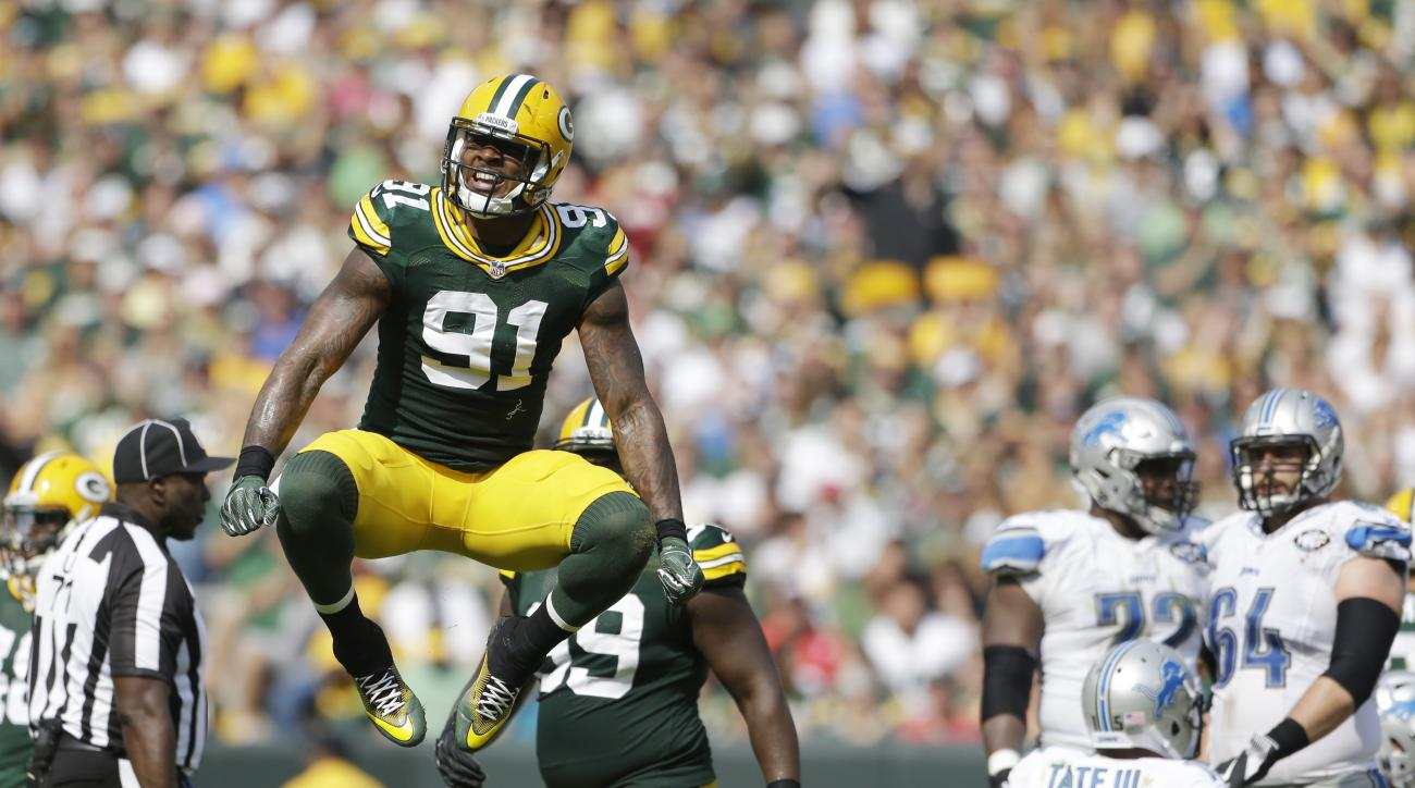 Green Bay Packers' Jay Elliott celebrates a tackle for a loss during the first half of an NFL football game against the Detroit Lions Sunday, Sept. 25, 2016, in Green Bay, Wis. (AP Photo/Jeffrey Phelps)