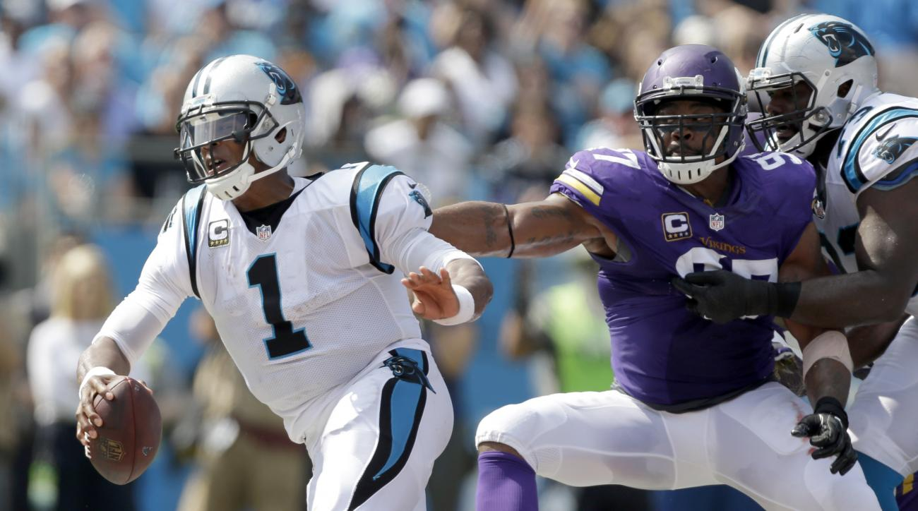Carolina Panthers' Cam Newton (1) is sacked by Minnesota Vikings' Everson Griffen (97) in the first half of an NFL football game in Charlotte, N.C., Sunday, Sept. 25, 2016. (AP Photo/Bob Leverone)