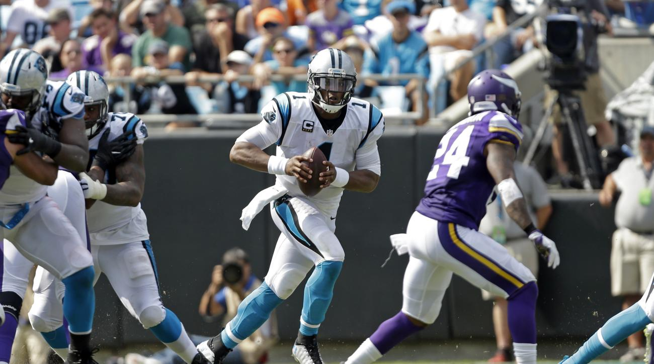 Carolina Panthers' Cam Newton (1) scrambles against Minnesota Vikings' Captain Munnerlyn (24) in the second half of an NFL football game in Charlotte, N.C., Sunday, Sept. 25, 2016. (AP Photo/Bob Leverone)