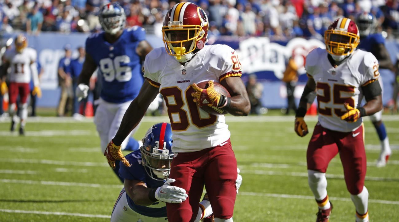 Washington Redskins wide receiver Jamison Crowder (80) breaks a tackle by New York Giants' Trevin Wade (31) to score a touchdown during the second half of an NFL football game Sunday, Sept. 25, 2016, in East Rutherford, N.J. (AP Photo/Kathy Willens)