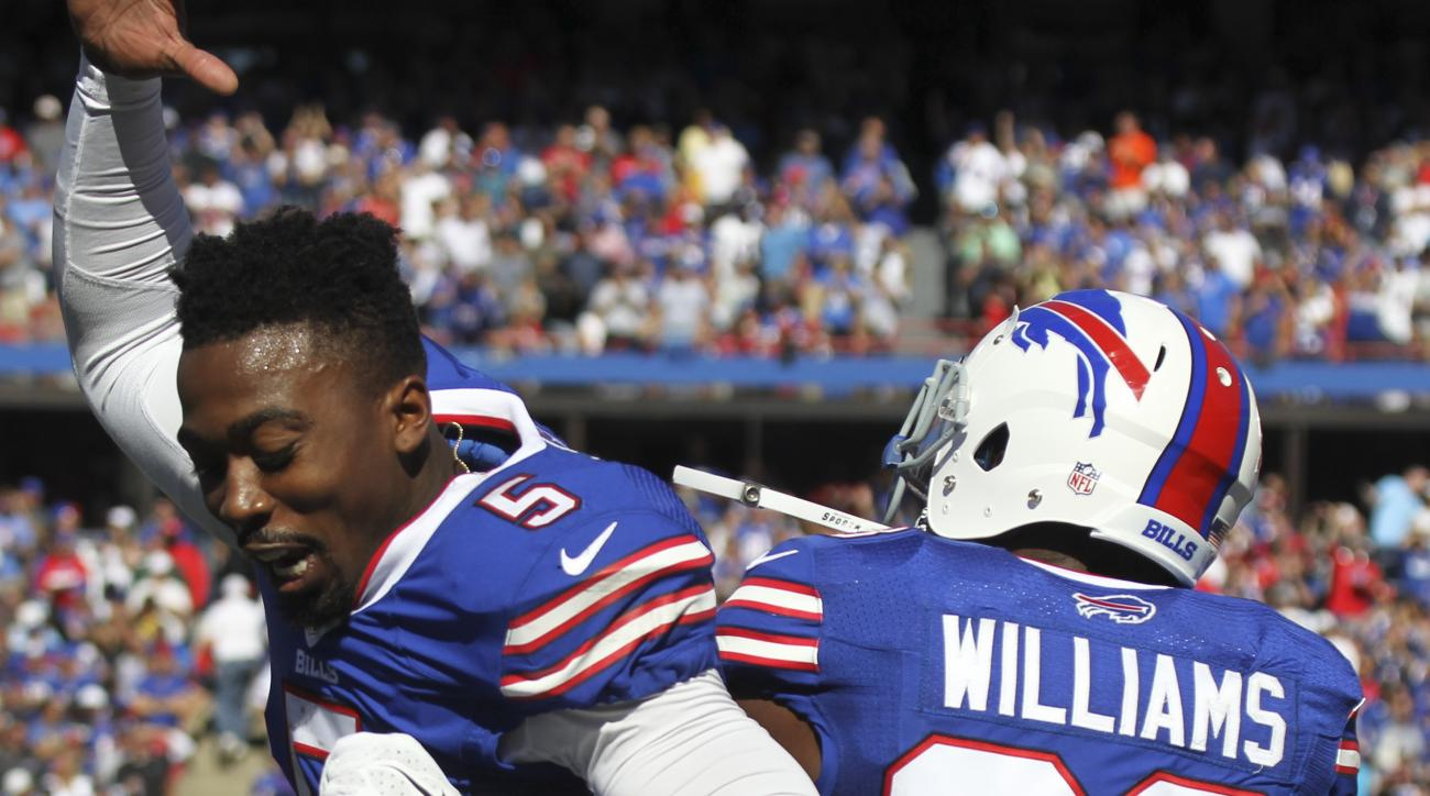 Buffalo Bills Aaron Williams (23) celebrates his touchdown with quarterback Tyrod Taylor (5) during the second half of an NFL football game on Sunday, Sept. 25, 2016, in Orchard Park, N.Y. Williams scored after Arizona lost the ball after it was snapped t
