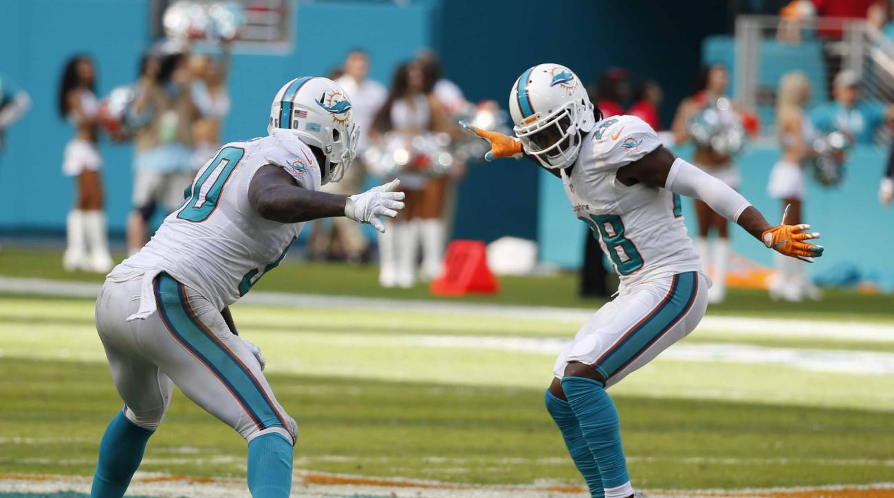 Miami Dolphins defensive end Andre Branch (50) and cornerback Bobby McCain (28) dance on the field after a field goal by the Cleveland Browns kicker Cody Parkey was no good seconds before the end of the second half of an NFL football game, Sunday, Sept. 2