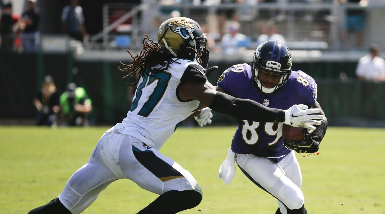 Baltimore Ravens wide receiver Steve Smith (89) runs as Jacksonville Jaguars strong safety Johnathan Cyprien (37) makes the tackle after a reception during the second half of an NFL football game in Jacksonville, Fla., Sunday, Sept. 25, 2016. (AP Photo/St