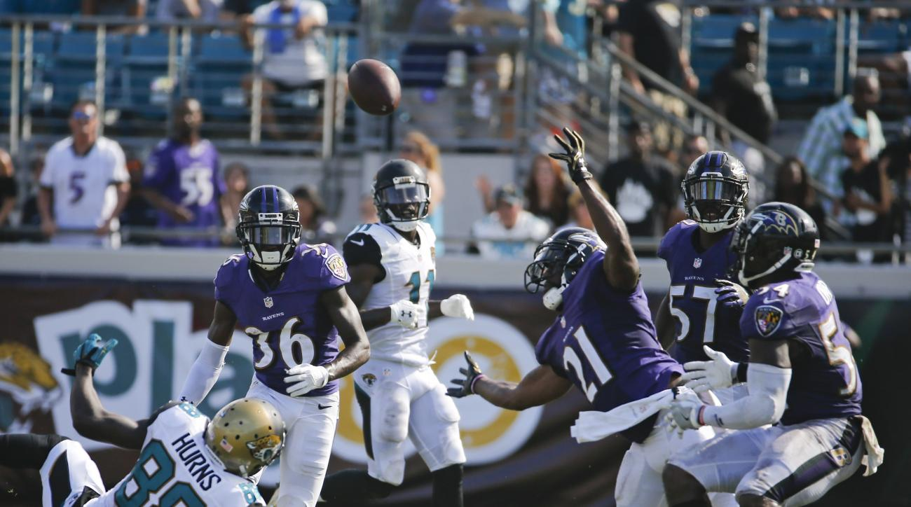Baltimore Ravens free safety Lardarius Webb (21) intercepts a pass intended for Jacksonville Jaguars wide receiver Allen Hurns (88) during the final moments of an NFL football game in Jacksonville, Fla., Sunday, Sept. 25, 2016. (AP Photo/Stephen B. Morton