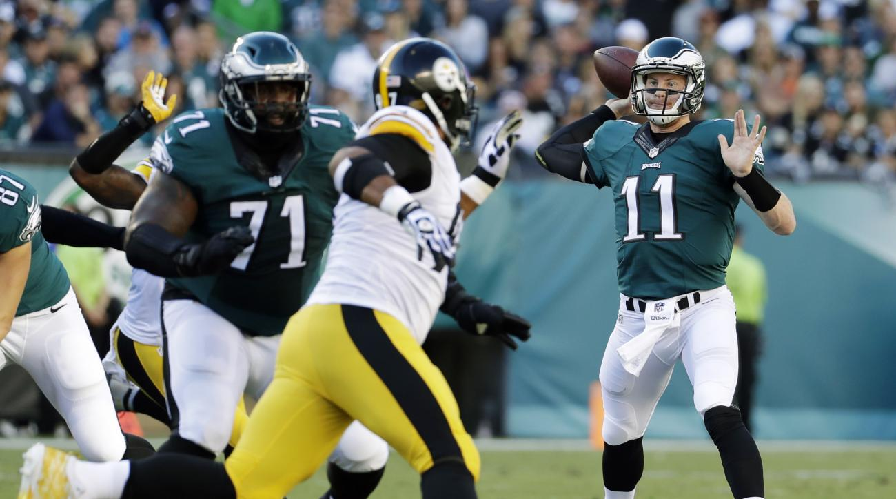 Philadelphia Eagles' Carson Wentz (11) passes during the first half of an NFL football game against the Pittsburgh Steelers, Sunday, Sept. 25, 2016, in Philadelphia. (AP Photo/Chris Szagola)