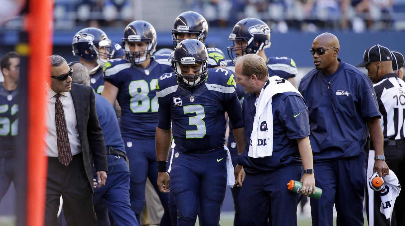 Seattle Seahawks quarterback Russell Wilson (3) is assisted off the field after being brought down against the San Francisco 49ers in the second half of an NFL football game, Sunday, Sept. 25, 2016, in Seattle. (AP Photo/Ted S. Warren)