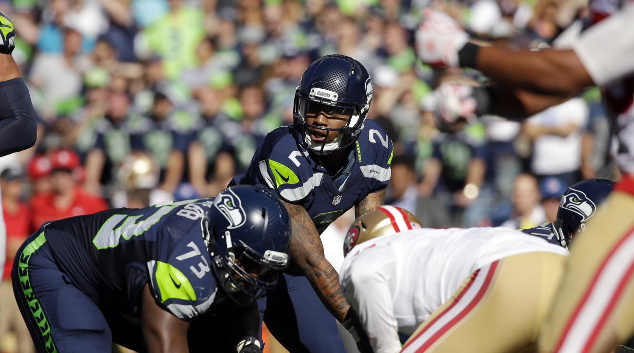 Seattle Seahawks quarterback Trevone Boykin lines up to take a snap against the San Francisco 49ers in the second half of an NFL football game, Sunday, Sept. 25, 2016, in Seattle. (AP Photo/Ted S. Warren)
