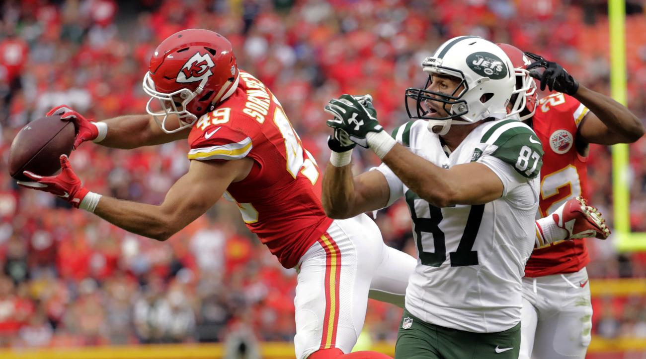Kansas City Chiefs defensive back Daniel Sorensen (49) nearly intercepts a ball intended for New York Jets wide receiver Eric Decker (87) during the second half of an NFL football game in Kansas City, Mo., Sunday, Sept. 25, 2016. Sorensen dropped the ball