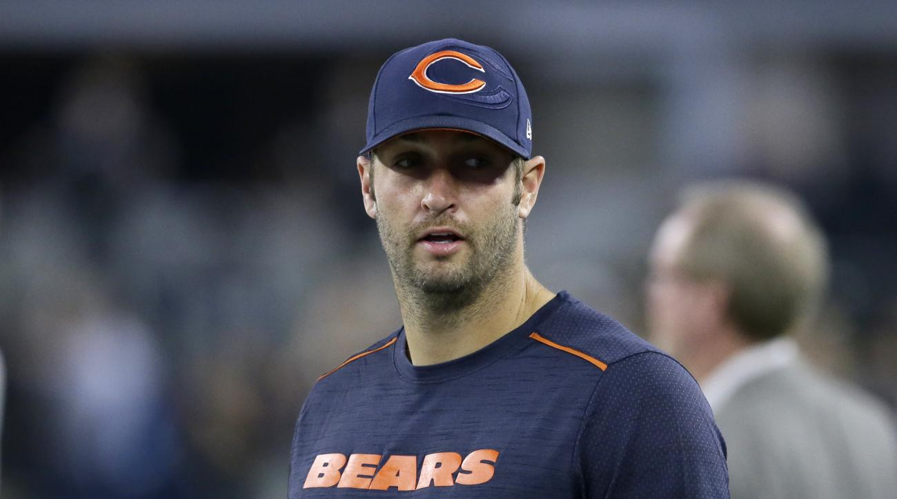 Chicago Bears quarterback Jay Cutler stands on the field watching the team warm up before an NFL football game against the Dallas Cowboys on Sunday, Sept. 25, 2016, in Arlington, Texas. (AP Photo/LM Otero)
