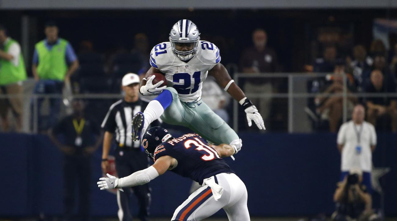 Dallas Cowboys running back Ezekiel Elliott (21) leaps over a tackle attempt by Chicago Bears' Chris Prosinski (31) in the second half of an NFL football game, Sunday, Sept. 25, 2016, in Arlington, Texas. (AP Photo/Ron Jenkins)