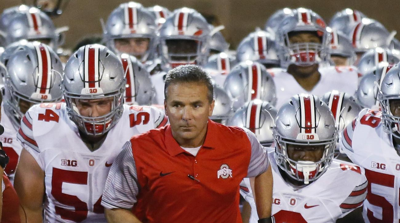 FILE - In this Sept. 17, 2016, file photo, Ohio State coach Urban Meyer leads his team onto the field for an NCAA college football game against Oklahoma in Norman, Okla. Meyer and the Buckeyes coaches did new Rutgers coach Chris Ash a solid this past summ