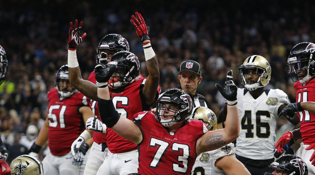 Atlanta Falcons tackle Ryan Schraeder (73) reacts to the official on a score by Tevin Coleman, not seen, duirng the first half of an NFL football game against the Atlanta Falcons in New Orleans, Monday, Sept. 26, 2016. (AP Photo/Butch Dill)