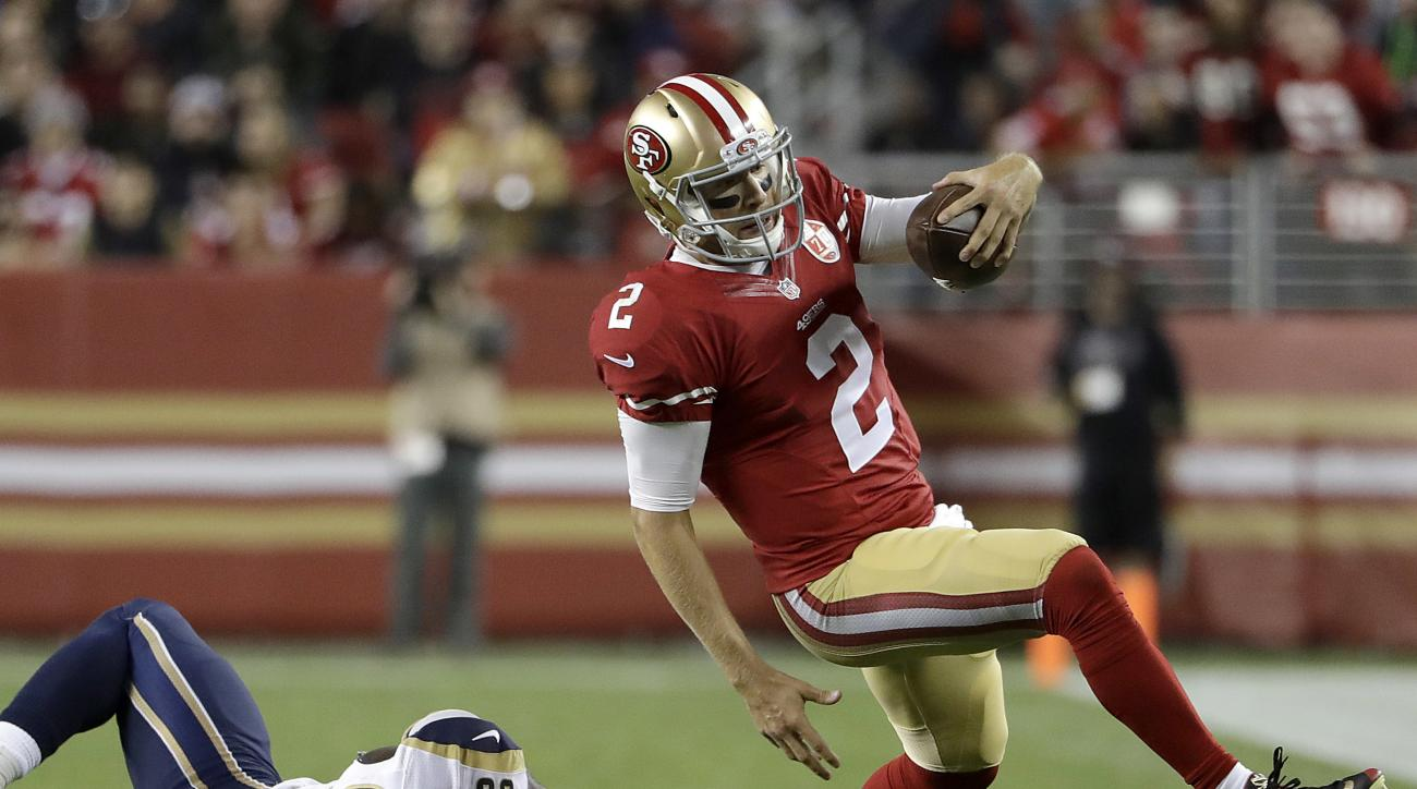 FILE - In this Sept. 12, 2016, file photo, San Francisco 49ers quarterback Blaine Gabbert (2) runs from Los Angeles Rams defensive end William Hayes during an NFL football game in Santa Clara, Calif. Gabbert has struggled to get the ball downfield for San