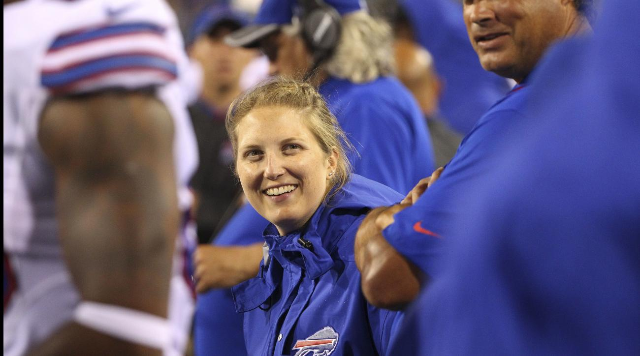 FILE - In this Aug. 13, 2016, file photo, Buffalo Bills special teams and quality control coach Kathryn Smith works from the sideline during the second half of a preseason NFL football game against the Indianapolis Colts in Orchard Park, N.Y.  In its repo