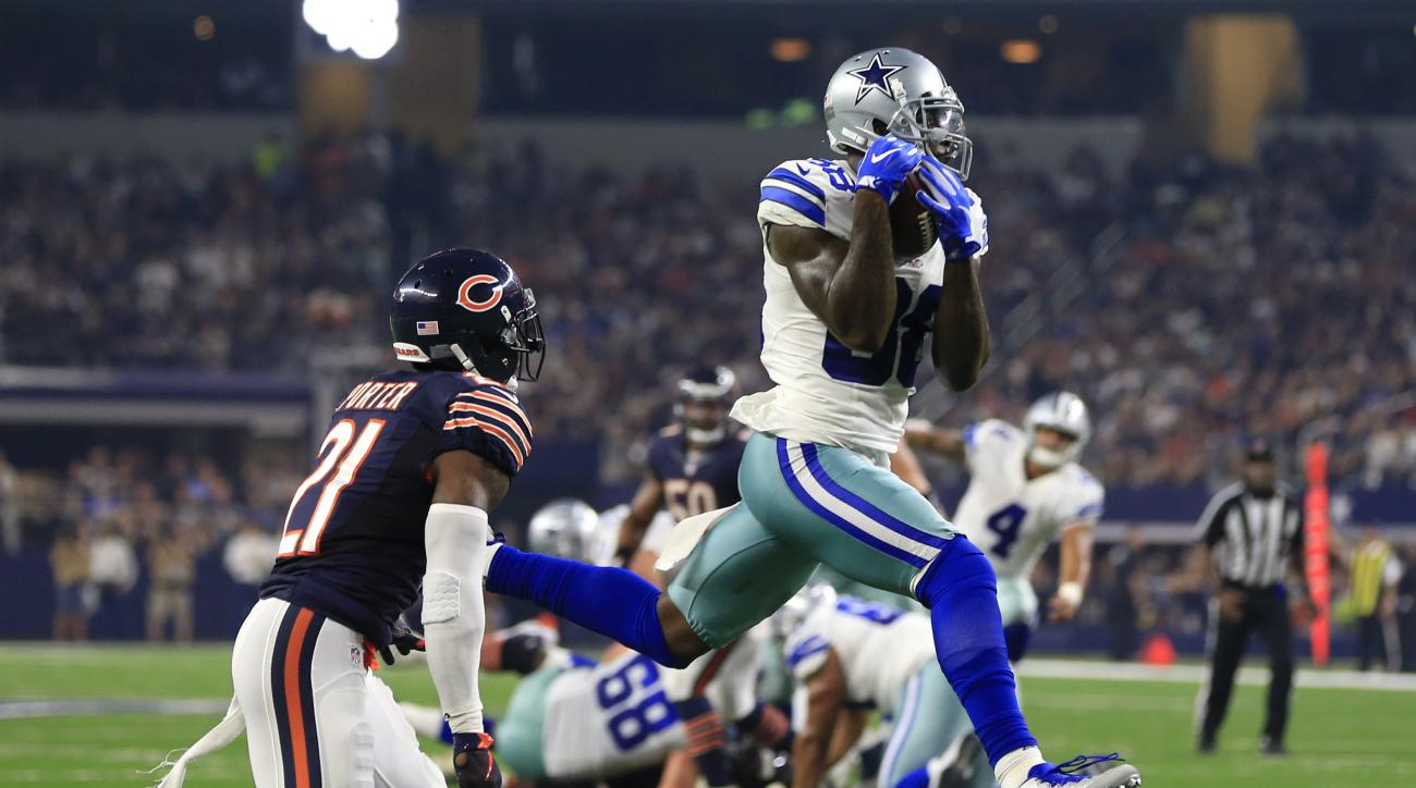 FILE - In this Sept. 25, 2016, file photo, Chicago Bears cornerback Tracy Porter (21) defends as Dallas Cowboys wide receiver Dez Bryant (88) catches a pass thrown by Dak Prescott (4) for a touchdown during the second half of an NFL football game in Arlin