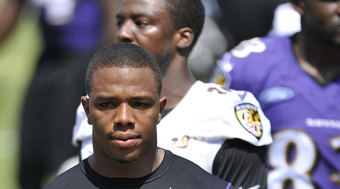 FILE - In this July 31, 2014, file phot, Baltimore Ravens running back Ray Rice walks off the field before addressing the media at a news conference at NFL football training camp in Owings Mills, Md. Unsigned for two years since the release of the horrifi