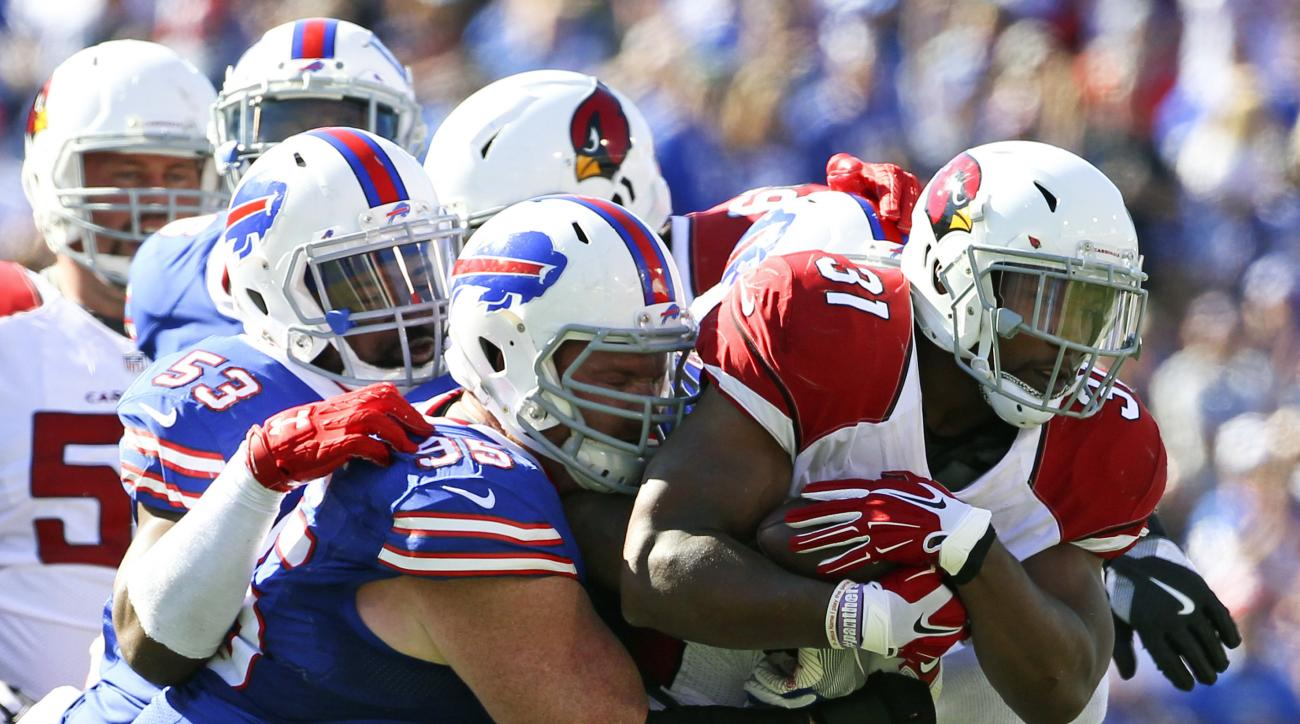 FILE - In this Sunday, Sept. 25, 2016, file photo, Arizona Cardinals running back David Johnson (31) is stopped by Buffalo Bills defenders Kyle Williams (95) and Zach Brown (53) during the second half of an NFL football game in Orchard Park, N.Y. Williams