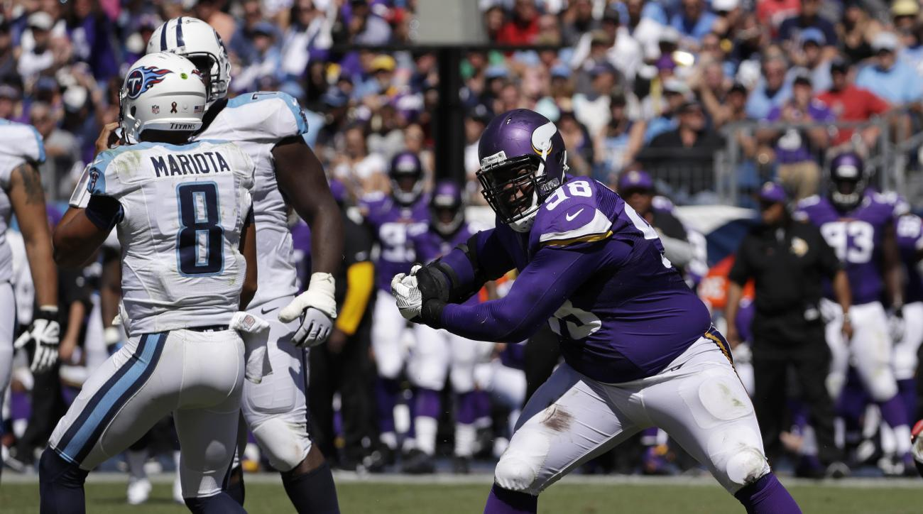 FILE - In this Sept. 11, 2016, file photo, Minnesota Vikings defensive tackle Linval Joseph (98) celebrates after sacking Tennessee Titans quarterback Marcus Mariota (8) for a 9-yard loss during the second half of an NFL football game in Nashville, Tenn.