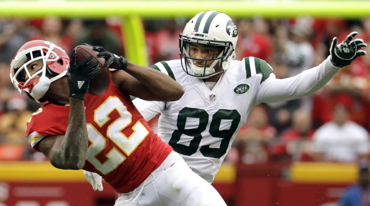 FILE - In this Sunday, Sept. 25, 2016, file photo, Kansas City Chiefs defensive back Marcus Peters (22) intercepts a pass intended for New York Jets wide receiver Jalin Marshall (89) during the first half of an NFL football game in Kansas City, Mo.. Kansa