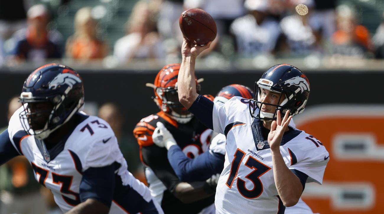 FILE - In this Sept. 25, 2016, file photo, Denver Broncos quarterback Trevor Siemian (13) throws during the first half of an NFL football game against the Cincinnati Bengals in Cincinnati. Siemian became the first quarterback to throw for 300 yards and fo