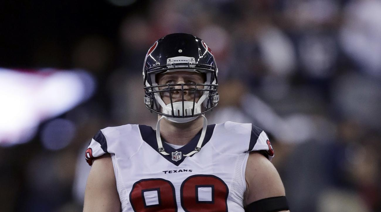 FILE - In this Sept. 22, 2016, file photo,Houston Texans defensive end J.J. Watt warms up before an NFL football game against the New England Patriots in Foxborough, Mass. The biggest defensive star in the Lone Star state is out. That's a void for the Hou