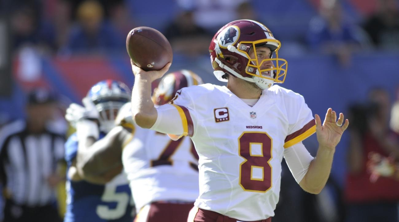 In this photo taken Sept. 25, 2016, Washington Redskins quarterback Kirk Cousins (8) throws a pass during the second half of an NFL football game against the New York Giants, in East Rutherford, N.J. (AP Photo/Bill Kostroun)